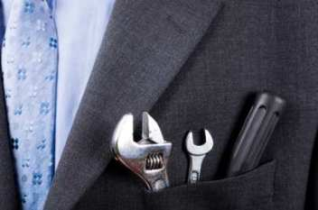Business man well-dressed with tool kit